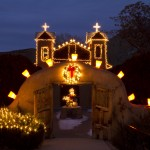 El Santuario de Chimayo outlined in luminarias for the Christmas season.